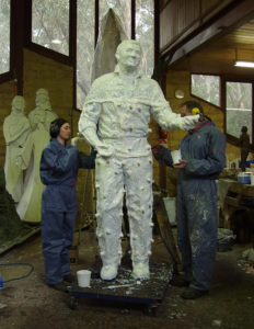 Bonny and Bill help prepare silicone rubber mould for Richie Benaud sculpture