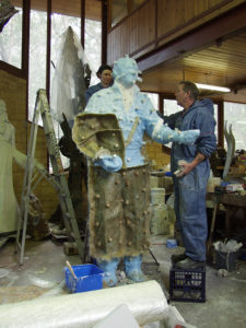 Bonny and Bill helping with fibreglass backing mould for Richie Benaud sculpture