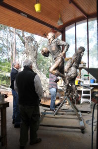 Basil Sellers and SCG Chairman Rodney Cavalier inspecting the cast bronze sculpture of Reg Gasnier