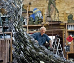 "Plowright working on a 2000 stainless steel piece, ""Life Teaming-Life Teeming"""
