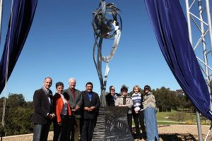 """Awakening Flower of Peace"" Stainless steel stands 5 metres high on the plinth, unveiled by State Minister and Local Councillors at the Gough Whitlam Park, Earlwood"