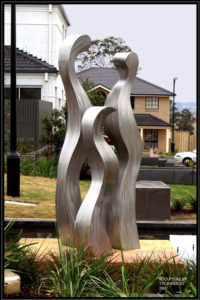 """Relationships"" Stainless steel sculpture, 3.3 metres high, part of a water feature. Sydney"