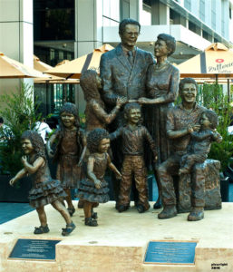"""""""Life from a Suitcase"""" Celebrating immigration into Australia, Life size, cast bronze, 9 figures taking 18 months to complete, weighs 2 tonne, located at Pyrmont Wharf, Sydney."""
