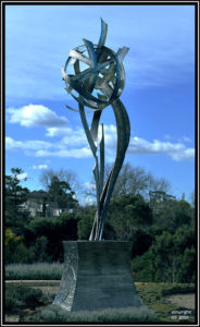 """Awakening Flower of Peace"" Stainless steel stands 5 metres high on the plinth"