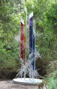 """Dancing Light"" 5.3 metres high, made from Plexiglass, stainless steel, coloured fluid, air compressor, and small computer. The work is interactive and kinetic"