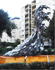 """Life Teeming – Life Teaming"" This sculpture is made from over 2000 pieces of 316 stainless steel and took over 12 months to complete. The stainless steel shoal and the sandstone plinth, together weigh over 10 tonne"