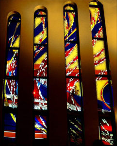 """""""THE SPIRIT OF HUMANITY, ARISING WITHIN THE MOST SACRED"""", chancel stained glass window, left-hand side of a 7m high work, St John's Church, Mt Druitt"""