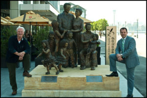 """""""Life from a Suitcase"""" Terrance Plowright with Paul Signorelli who commissioned this sculpture representing 3 generations of his family members in the 9 figures"""