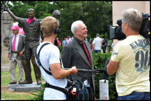 Terrance Plowright being interviewed for television at Steve Waugh sculpture unveiling
